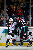 KELOWNA, CANADA - OCTOBER 3:  Ted Brennan #10 of the Kelowna Rockets checks Alex Kannok Leipert #41 of the Vancouver Giants at the boards on October 3, 2018 at Prospera Place in Kelowna, British Columbia, Canada.  (Photo by Marissa Baecker/Shoot the Breeze)  *** Local Caption ***