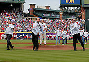 ATLANTA, GA - OCTOBER 2:  Former Atlanta Braves pitchers (from left to right) Tom Glavine, John Smoltz and Greg Maddux throw the ceremonial first pitch during pre-game ceremonies to honor the last game at Turner Field during the game between the Detroit Tigers and the Atlanta Braves on Sunday, October 2, 2016 in Atlanta, Georgia. (Photo by Mike Zarrilli/MLB Photos via Getty Images) *** Local Caption ***
