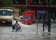 A child makes his way through a flash flood that hit downtown Phnom Phen.