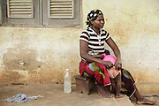 A woman helps her daughter get dressed in the town of Katiola, Cote d'Ivoire on Saturday July 13, 2013.