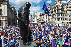© Licensed to London News Pictures. 20/07/2019. London, UK. Thousands of anti-Brexit protesters march past the Winston Churchill statue in Parliament Square during the March for Change in London. Photo credit: Rob Pinney/LNP