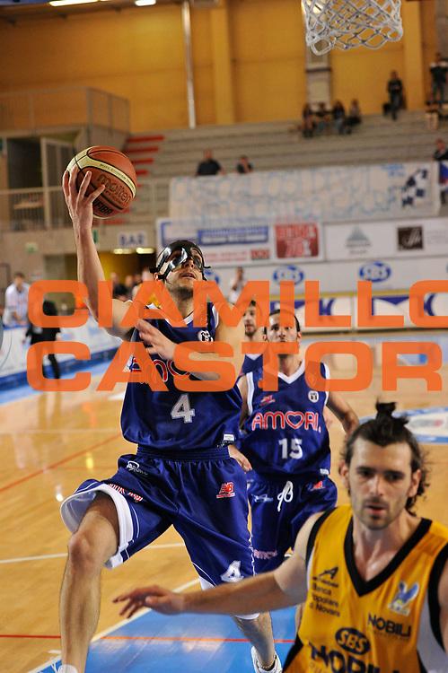 DESCRIZIONE : Castelletto Sopra Ticino LNP A 2009-10 Playoff Nobili SBS Castelletto Amori Fortitudo Bologna<br /> GIOCATORE : Muro<br /> SQUADRA : Amori Fortitudo Bologna<br /> EVENTO : Campionato LNP A 2009-2010<br /> GARA : Nobili SBS Castelletto - Amori Fortitudo Bologna<br /> DATA : 29/04/2010<br /> CATEGORIA : Tiro<br /> SPORT : Pallacanestro <br /> AUTORE : Agenzia Ciamillo-Castoria/D.Pescosolido