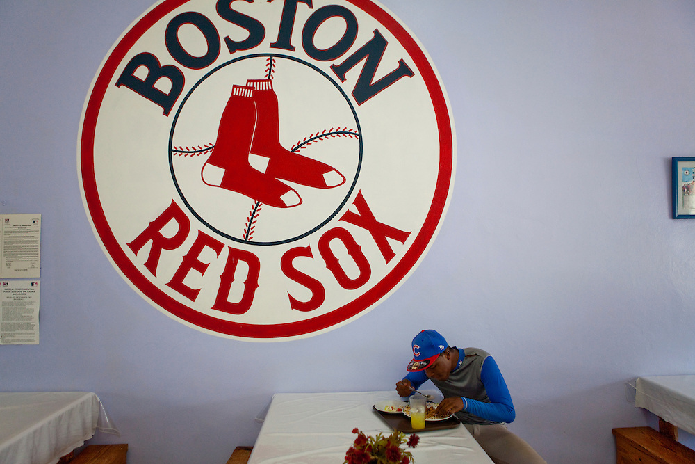 Sonto Jesus, a center fielder from Santo Domingo, eats lunch at a training camp owned by the Boston Red Sox on Thursday, February 25, 2010 in San Antonio de Guerra, Dominican Republic.