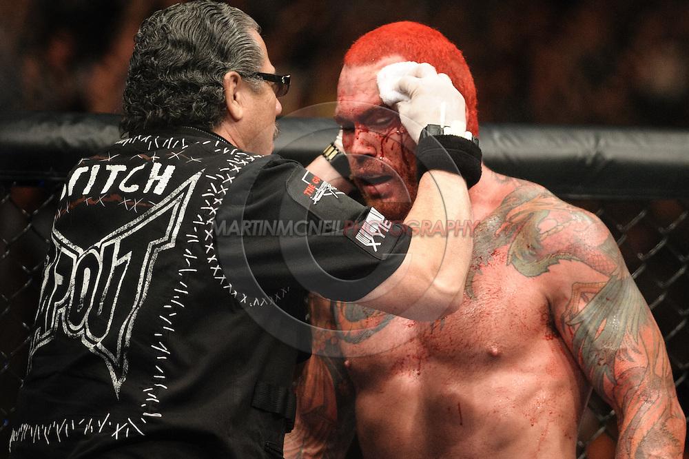 "BIRMINGHAM, ENGLAND, NOVEMBER 5, 2012: Cutman Jacob Duran (left) attends to a wound above Chris Leben's left eye during ""UFC 138: Munoz vs. Leben"" inside the National Indoor Arena in Birmingham, United Kingdom"