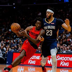 Jan 12, 2018; New Orleans, LA, USA; Portland Trail Blazers forward Al-Farouq Aminu (8) drives past New Orleans Pelicans forward Anthony Davis (23) during the second half at the Smoothie King Center. The Pelicans defeated the Trail Blazers 119-113. Mandatory Credit: Derick E. Hingle-USA TODAY Sports