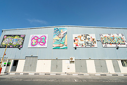 Paintings on warehouse wall at Alserkal art district in Al Quoz Dubai United Arab Emirates