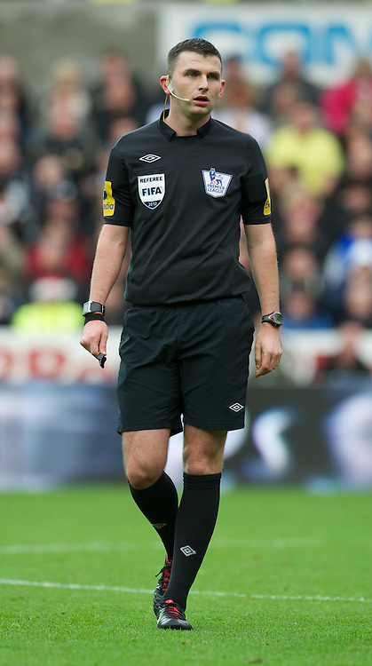 SWANSEA, WALES - Sunday, December 23, 2012: Referee Michael Oliver takes charge of Swansea City versus Manchester United during the Premiership match at the Liberty Stadium. (Pic by David Rawcliffe/Propaganda)