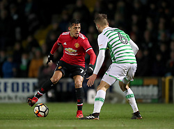 Manchester United's Alexis Sanchez (left) and Yeovil Town's Lewis Wing (right) during the Emirates FA Cup, fourth round match at Huish Park, Yeovil.