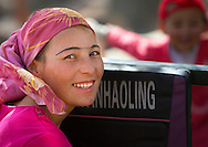 Smiling Uyghur woman, Opal village market, Xinjiang Uyghur autonomous region, China.