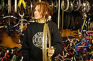 Canada, Ontario, Kitchener. November 30, 2007. A teenage youth volunteers at the Working Centre's Recyle Cycles store. The Working Centre is a volunteer inspired organisation that provides individuals and groups certain tools for community  building.