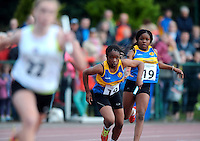 20 Aug 2016: Teni Alaba, right, Longford, hands the baton to Rachel Akeymeni who runs the final leg of Girls U14 4x100 Relay.   2016 Community Games National Festival 2016.  Athlone Institute of Technology, Athlone, Co. Westmeath. Picture: Caroline Quinn