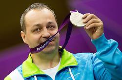Francek Gorazd Tirsek of Slovenia celebrates at medal ceremony after winning second place during the Men's R4-10m Air Rifle Standing shooting Final during Day 5 of the Summer Paralympic Games London 2012 on September 2, 2012, in Royal Artillery Barracks, London, Great Britain. (Photo by Vid Ponikvar / Sportida.com)