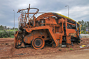 Damaged and Burnt, rusty combine harvester. Photographed in Israel