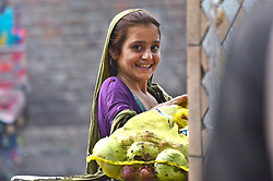 July 28, 2017 - Lahore, Punjab, Pakistan - Afghan girls collecting usable fruits and vegetables form Badami Bagh market.  Pakistan is among 11 countries which carry almost 50 pcs. of the global burden of chronic hepatitis. (Credit Image: © Rana Sajid Hussain/Pacific Press via ZUMA Wire)