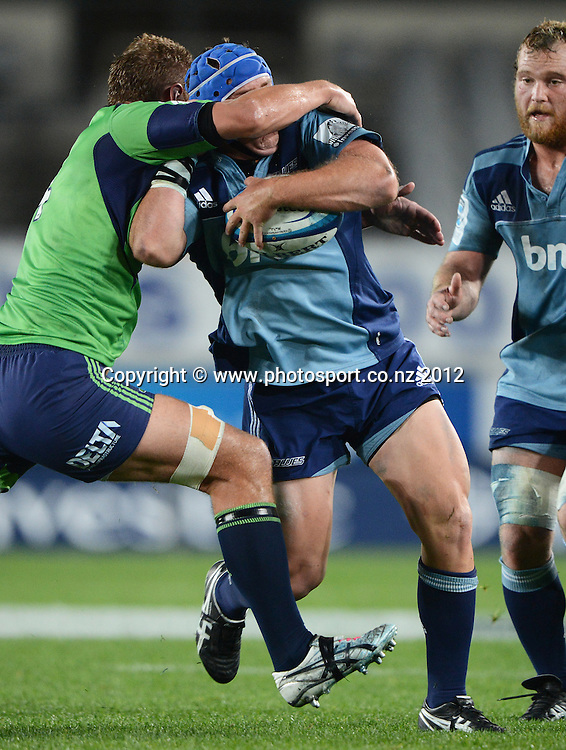 Jarrad Hoeata tackles Blues Hooker James Parsons during the Blues and Highlanders at Eden Park, Auckland, New Zealand on Saturday 26 May 2012. Photo: Andrew Cornaga/Photosport.co.nz