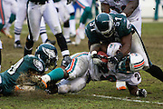 PHILADELPHIA - NOVEMBER 18: The Philadelphia Eagles defense bring the ball carrier down during the game against the Miami Dolphins on November 18, 2007 at Lincoln Financial Field in Philadelphia, Pennsylvania.
