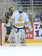LSSU goalie Brian Mahoney-Wilson looks up at the overhead scoreboard after giving up a fifth goal to the visiting Michigan Wolverines Friday at Taffy Abel Arena in Sault Ste. Marie.