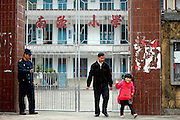 "NANJING, CHINA -  (CHINA OUT) <br /> <br /> A School Only Has A Teacher And A Student<br /> <br /> Teacher Zhang Jiawan and grade one student Zhang Siqi play basketball during a PE class at Nan'ou Primary School in Nanjing County, Fujiang Province of China. The Nan'ou primary school, which is located in Nan'ou village, Shuyang town of Nanjing county, only has three people, 56-year-old teacher Zhang Jiawan, seven-year-old student Zhang Siqi and 39-year-old security guard Zhang Zhixian. The school only has grade one, all the students will be transferred to primary schools in Shuyang town when they go up to a higher grade. Nan'ou primary school was closed in 2009 and 2010, but reopened in 2011 as a result of thinking of Nan'ou village's practical situation. So Zhang Siqi was lucky to start to study in her native village in September 2012. Zhang Siqi was bron with incomplete vertebrae, which left her fecal and urine incontinence. She needs her family's care and can't stay away from home. ""The Shuyang town is about 9 km away from home, I have to let her repeat the first grade next year,"" Zhang Siqi's father said. Abandoned schools are becoming a more common sight in rural China. The vast disappearance of rural schools was triggered by a government strategy in 2000 to remove village schools and consolidate education resources in counties and townships. <br /> ©ChinaFoto/Exclusivepix"