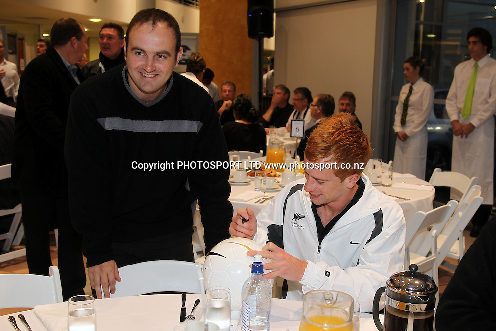 All Whites player Aaron Clapham signs a ball for a guest.<br />All Whites Breakfast at Giltrap Prestige in Auckland. 21 May 2010. New Zealand Football Team prior to the FIFA 2010 Football Cup in South Africa.<br />Photo: Andrew Cornaga/PHOTOSPORT
