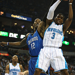18 February 2009: New Orleans Hornets guard Chris Paul (3) grabs a rebound over Orlando Magic center Dwight Howard (12) during a NBA basketball game between the Orlando Magic and the New Orleans Hornets at the New Orleans Arena in New Orleans, Louisiana.