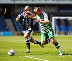 Yeovil Town's Paddy Madden and Millwall's Richard Chaplow - Photo mandatory by-line: Seb Daly/JMP - Tel: Mobile: 07966 386802 03/08/2013 - SPORT - FOOTBALL - The Den - Millwall -  Millwall V Yeovil Town - Sky Bet Championship