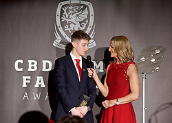 CARDIFF, WALES - Thursday, March 21, 2019: Wales' David Brooks is interviewed on stage ny host Gabby Logan during the Football Association of Wales Awards 2019 at the Hensol Castle. (Pic by Ian Cook/Propaganda)