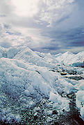 Matanuska Glacier with stormy clouds and sun breaking through.