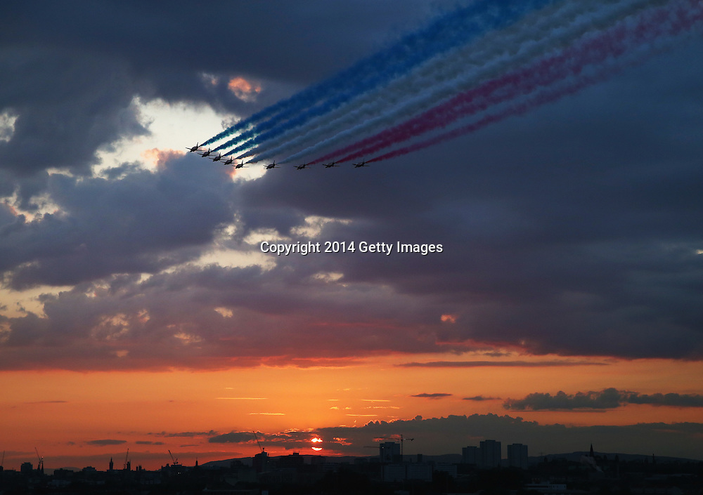 GLASGOW, SCOTLAND - JULY 23:  The RAF Red Arrows fly over Glasgow during the Opening Ceremony for the Glasgow 2014 Commonwealth Games at Celtic Park on July 23, 2014 in Glasgow, United Kingdom.  (Photo by Ryan Pierse/Getty Images)