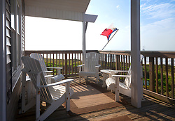 The Texas flag flies over an empty deck at a beach house in Spanish Grant, Galveston Island, Texas Gulf Coast.
