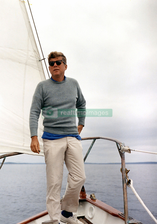 John F. Kennedy, the nation's 35th President, would have turned 100 years old on May 29, 2017. With the centennial anniversary of John F. Kennedy's birth, the former president's legacy is being celebrated across the nation. PICTURED: Dec. 01, 2000 - Hyannis Port, Massachusetts, U.S. - U.S. President JOHN F KENNEDY aboard a sailboat, wearing sunglasses, circa 1960's. (Credit Image: © John F. Kennedy Library/ZUMAPRESS.com)