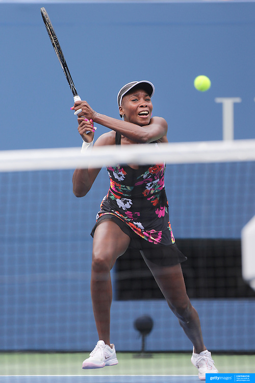 Venus Williams, USA, in action against Kirsten Flipkens, Belgium, during the Women's Singles at the US Open. Flushing. New York, USA. 25th August 2013. Photo Tim Clayton