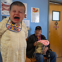 "First place winner for the senior halloween costume contest Grace Begay, left, dressed as a ""crying baby"" scares Pete Becenti, right, with a quick cry for her bottle at the Senior Center in Gallup."