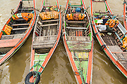 18 JUNE 2013 - YANGON, MYANMAR:  RIver taxis tied up at a pier in Yangon.      PHOTO BY JACK KURTZ