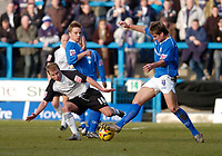Photo: Leigh Quinnell.<br /> Chesterfield v Southend United. Coca Cola League 1. 18/02/2006. Chesterfields Janos Kovacs reaches the ball before Southends Luke Guttridge.