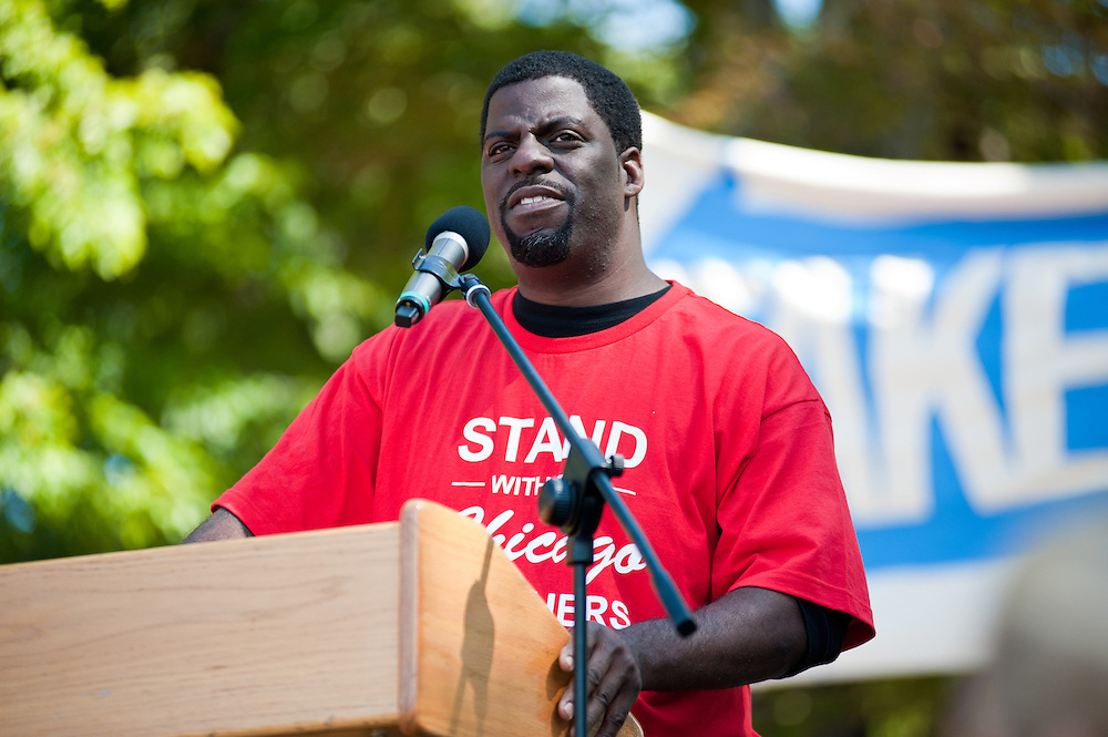 "Che ""Rhymefest"" Smith speaks at the Chicago Teachers Union rally in Union Park on September 15, 2012."