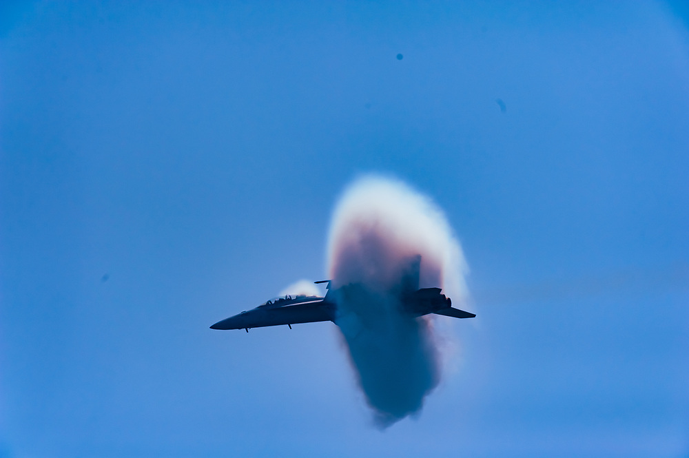 A shock wave forms on a U.S. Navy F/A-18F Super Hornet as it approaches the sound barrier during its display at the 2012 Bethpage Air Show at Jones Beach.