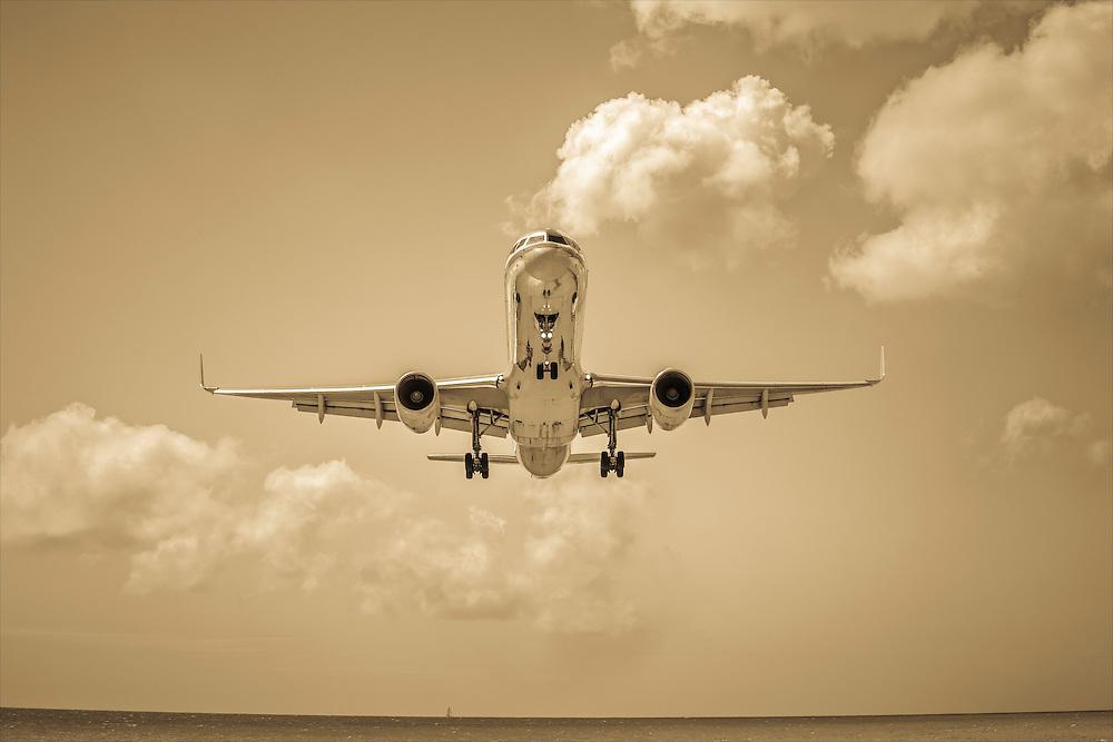 An American Airlines jet on final approach to Princess Juliana International Airport (SXM) in St. Maarten.
