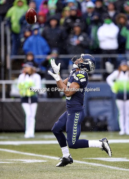 Seattle Seahawks wide receiver Tyler Lockett (16) looks up for the ball as he returns a kick during the 2015 NFL week 16 regular season football game against the St. Louis Rams on Sunday, Dec. 27, 2015 in Seattle. The Rams won the game 23-17. (©Paul Anthony Spinelli)