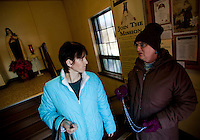 "CHAMPION, WI - DECEMBER 22: Theresa Vandermause, left, of Thiry Dames Wis. holds the door for Judy Deprey, right, of Dyckesville Wis. as they go to pray to the Blessed Virgin Mary at the Shrine of Our Lady of Good Help in a small rural town in northern Wisconsin, December 22, 2010 in Champion, Wisconsin. After years of research, the Bishop of Green Bay determined that the sightings of Mary ""clothed in dazzling white"" are indeed ""worthy of belief"" and now have now been officially sanctioned as real by the Vatican. This shrine is the first of such for the United States and now joins the company of Lourdes and Fatima.   (Darren Hauck )"