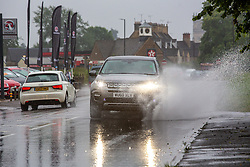© Licensed to London News Pictures 25/06/2109, Cirencester, UK. Commuters tackle terrible conditions on the roads as torrential rain creates dangerous driving conditions. Photo Credit : Stephen Shepherd/LNP