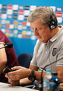England manager Roy Hodgson struggles to get his translation headset working during the England press conference the day before their final Group D match against Costa Rica at Mineirao, Belo Horizonte, Brazil. <br /> Picture by Andrew Tobin/Focus Images Ltd +44 7710 761829<br /> 23/06/2014