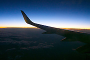 Uzbekistan. Flying along the silk road at dawn aboard an Air Baltic Boeing 737 jet plane.