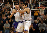 Hedo Turkoglu (left) and Peja Stojakovic do a bump at mid court after Hedo made a 3 pointer with the shot clock running down, late in the 4th quarter. PIcture taken at Arco Arena, Saturday, November 24, 2001. New Jersey Nets vs Sacramento Kings.