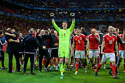 LILLE, FRANCE - Friday, July 1, 2016: Wales' goalkeeper Wayne Hennessey celebrates a 3-1 victory over Belgium and reaching the Semi-Final during the UEFA Euro 2016 Championship Quarter-Final match at the Stade Pierre Mauroy. (Pic by David Rawcliffe/Propaganda)