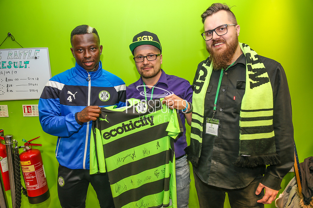 Forest Green Rovers Drissa Traoré(4) with the match sponsor during the EFL Sky Bet League 2 match between Forest Green Rovers and Swindon Town at the New Lawn, Forest Green, United Kingdom on 22 September 2017. Photo by Shane Healey.