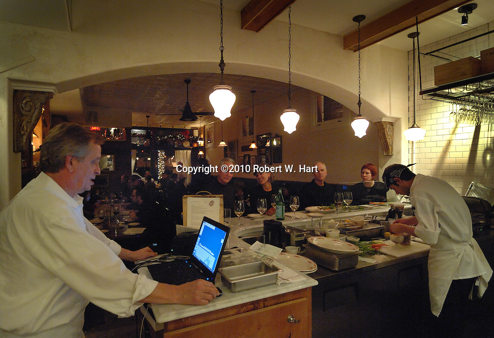 Lucia restaurant waiter Wally Chvojan, left, and cook Drew Marquis at work at Lucia Tuesday December 14 evening.