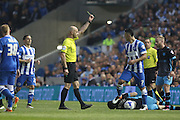 Referee Roger East shows yellow card to Brighton central midfielder, Beram Kayal (7) during the Sky Bet Championship play-off second leg match between Brighton and Hove Albion and Sheffield Wednesday at the American Express Community Stadium, Brighton and Hove, England on 16 May 2016. Photo by Phil Duncan.