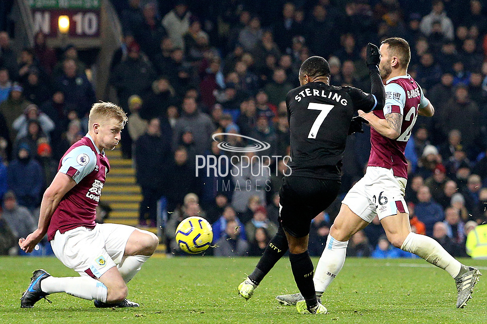 Burnley defender Ben Mee (6) blocks the shot from Manchester City midfielder Raheem Sterling (7) during the Premier League match between Burnley and Manchester City at Turf Moor, Burnley, England on 3 December 2019.