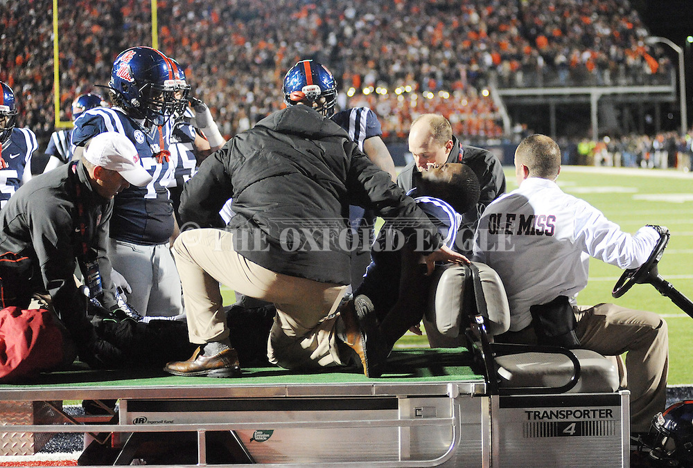 Ole Miss' wide receiver Laquon Treadwell (1) is taken off the field after being injured vs. Auburn at Vaught-Hemingway Stadium in Oxford, Miss. on Saturday, November 1, 2014. Auburn won 35-31.(AP Photo/Oxford Eagle, Bruce Newman)