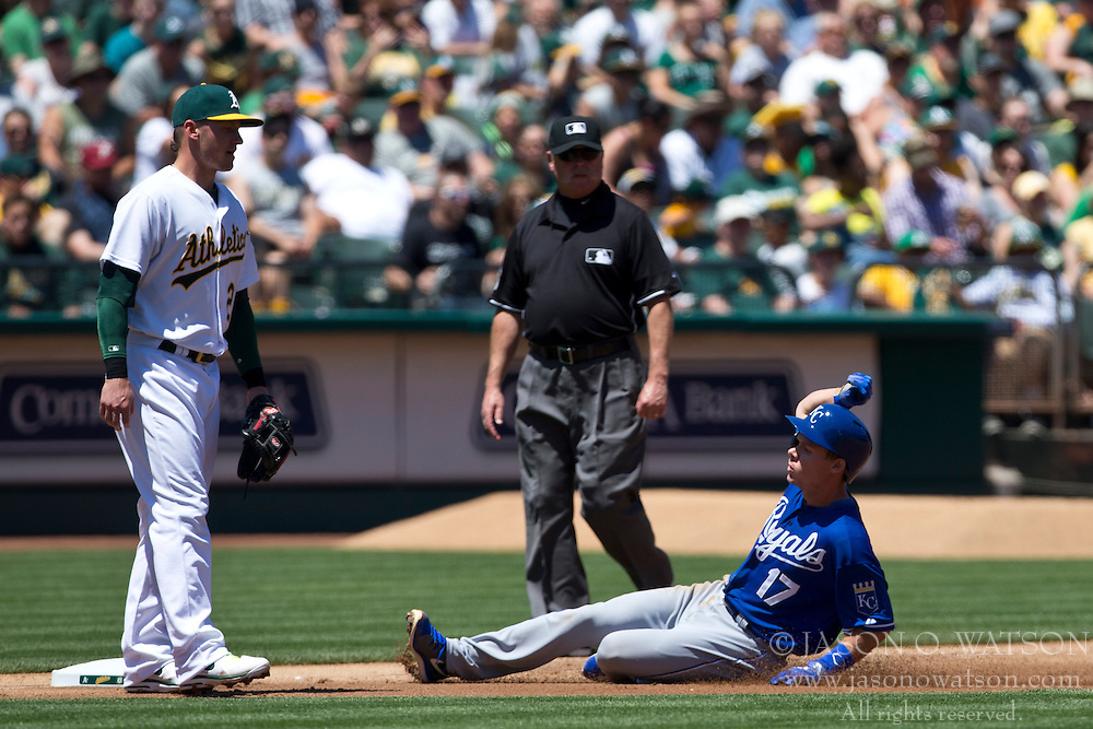 OAKLAND, CA - MAY 19: Chris Getz #17 of the Kansas City Royals slides into third base in front of Josh Donaldson #20 of the Oakland Athletics during the third inning at O.co Coliseum on May 19, 2013 in Oakland, California. The Oakland Athletics defeated the Kansas City Royals 4-3. (Photo by Jason O. Watson/Getty Images) *** Local Caption *** Chris Getz; Josh Donaldson